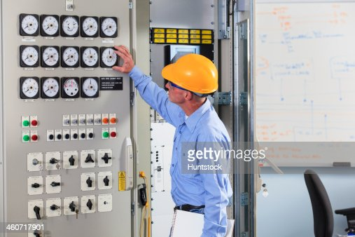 Electrical Engineer Inspecting Power Plant Controls In Central ...