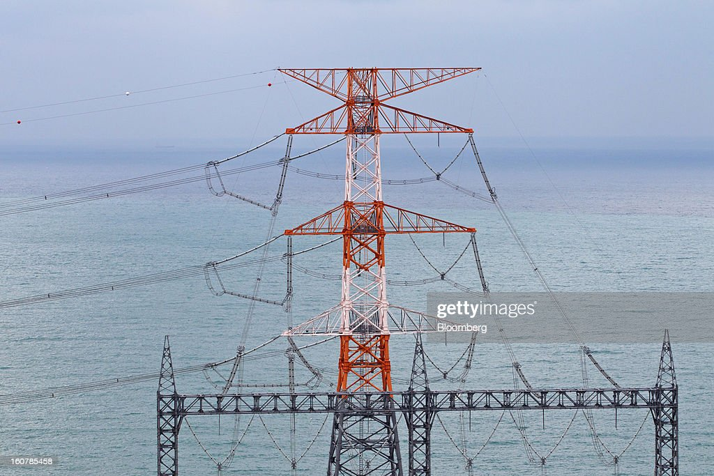Electrical lines leading from Korea Hydro & Nuclear Power Co.'s Shin-Kori nuclear power plant hang from a transmission tower in Ulsan, South Korea, on Tuesday, Feb. 5, 2013. Korea Hydro, a unit of Korea Electric Power Corp. (Kepco), operates 23 reactors in the country. Photographer: SeongJoon Cho/Bloomberg via Getty Images