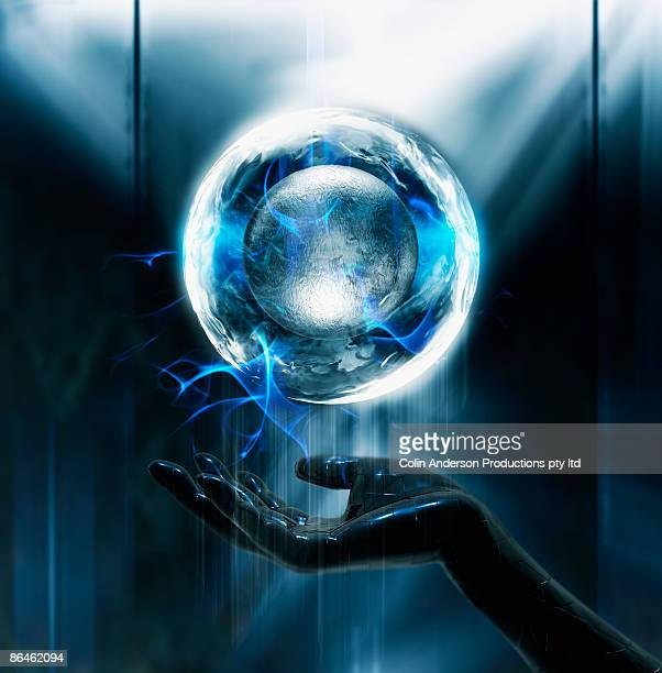 Electrical orb floating above hand