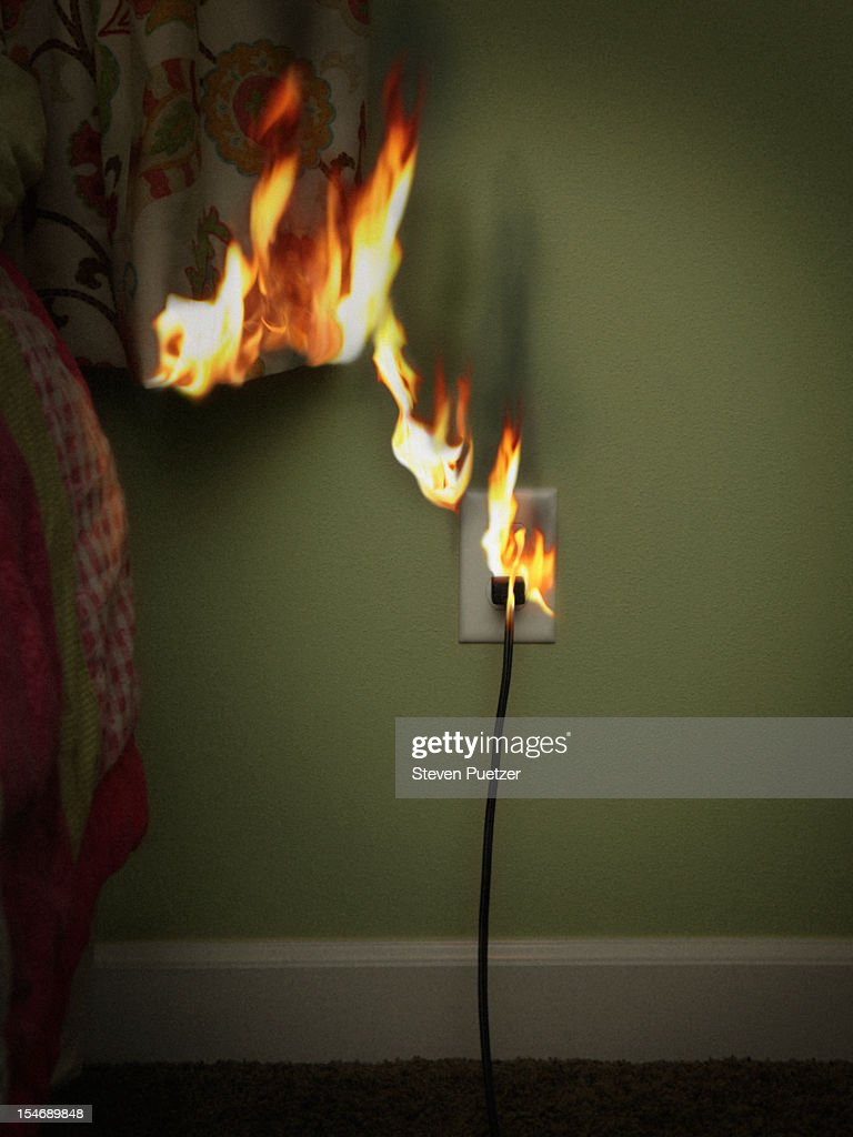 Electrical Outlet And Curtain On Fire : Stock Photo