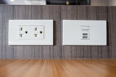 Electrical outlet with built in USB charger for service customers at table in restaurant in Thailand