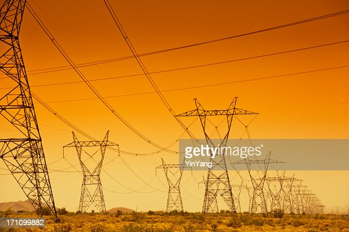 Electrical Power Line Grid Across the Landscape at Sunset