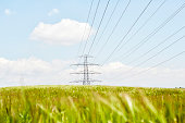 Electrical tower in field