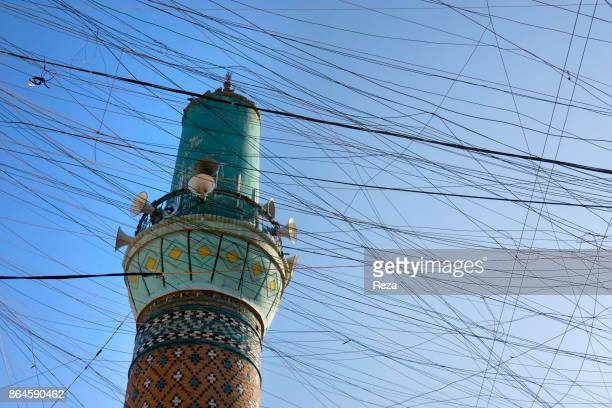 Electrical wires corssing over the sky around the minaret The electricity was delivered thanks to city's infrastructures and private generators that...