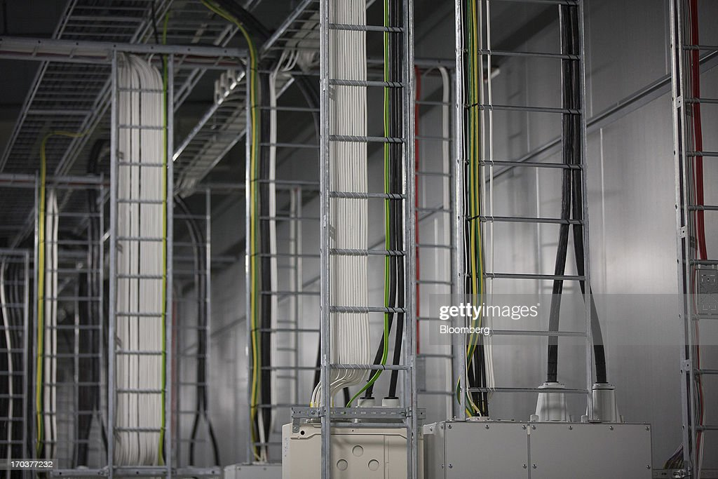 Electrical wires hang inside the fan room used to cool the server halls inside Facebook Inc.'s new data storage center near the Arctic Circle in Lulea, Sweden, on Wednesday, June 12, 2013. The data center is Facebook's first outside the U.S., poised to handle all data processing from Europe, Middle East and Africa and the server hub is largest of its kind in Europe, and most northerly of its magnitude anywhere on earth. Photographer: Simon Dawson/Bloomberg via Getty Images