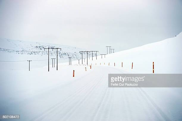 Electrical wiring and Snow Covered road at Dyrafjordur Westfjords Iceland