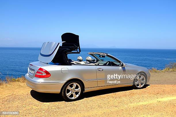 Electrically operated folding roof of 2005 Mercedes-Benz CLK500 opening