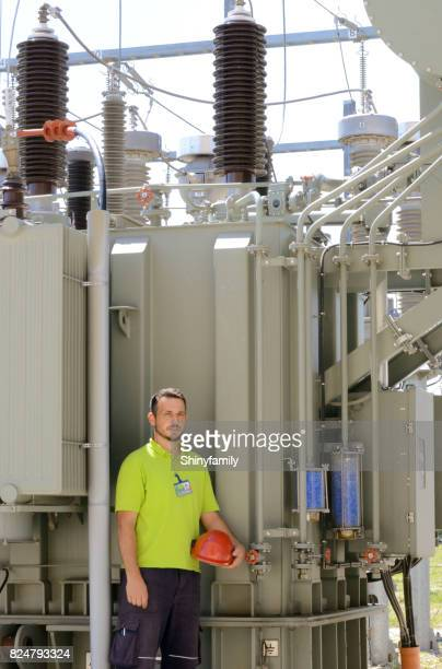Electrician checks the equipment on transformer in power station