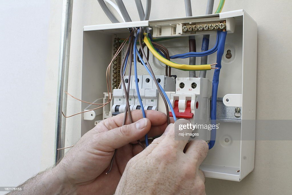 electrician connecting up a fuse box picture id182176153 electrician connecting up a fuse box stock photo getty images fuse box ireland at n-0.co