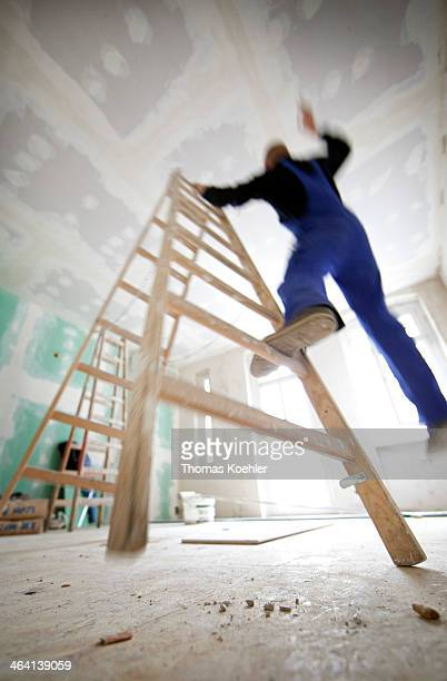Electrician falling from a wooden stepladder in an old building on May 15 in Berlin Germany Photo by Thomas Koehler/Photothek via Getty Images