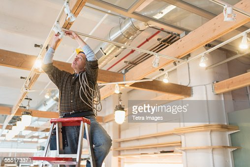 Electrician fixing lightning equipment