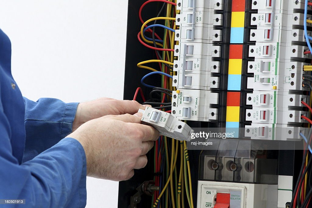 electrician installing circuit breaker in a fuse box picture id182501913 electrician installing circuit breaker in a fuse box stock photo installing fuse box on boat at gsmx.co