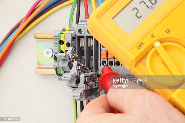 Electrician testing for voltage.