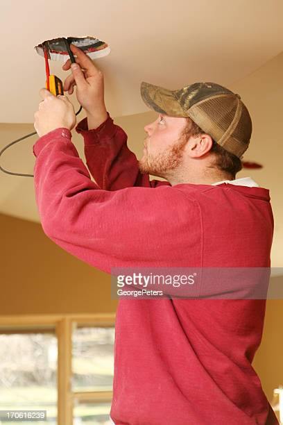 Electrician Testing Wires