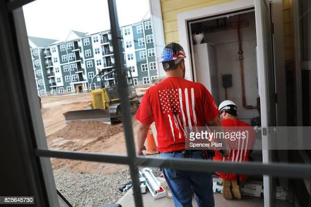 Electricians finish a building at Canal Crossing a luxury apartment community consisting of 393 rental units near the university city of New Haven on...