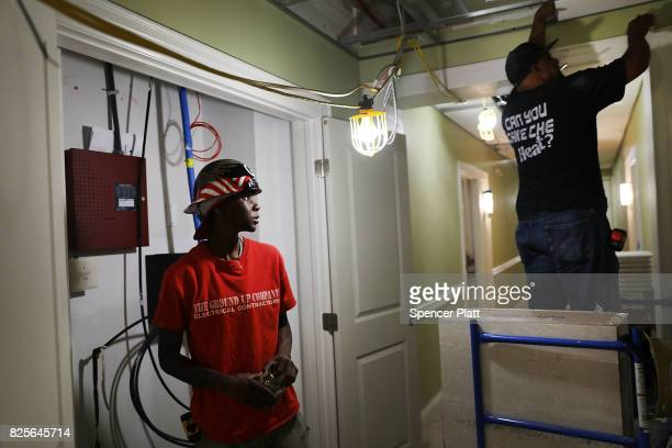 Electricians finish a hallway at Canal Crossing a luxury apartment community consisting of 393 rental units near the university city of New Haven on...