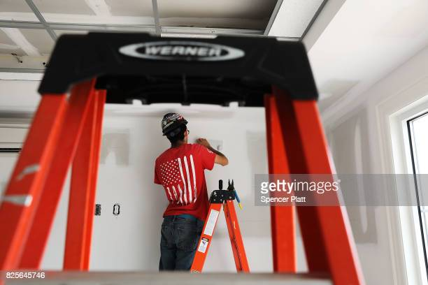 Electricians finish a room at Canal Crossing a luxury apartment community consisting of 393 rental units near the university city of New Haven on...