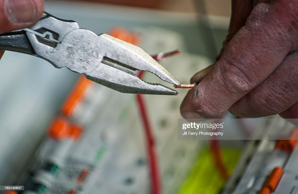 Electricians hands : Stock Photo