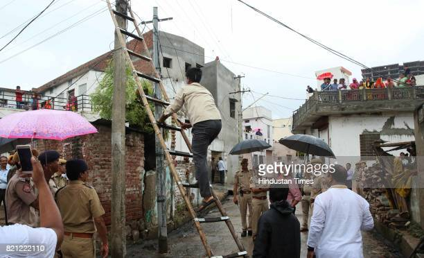 Electricians make last minute maintenance before BJP National President Amit Shah's arrival for the lunch at a dalit's home on the concluding day of...