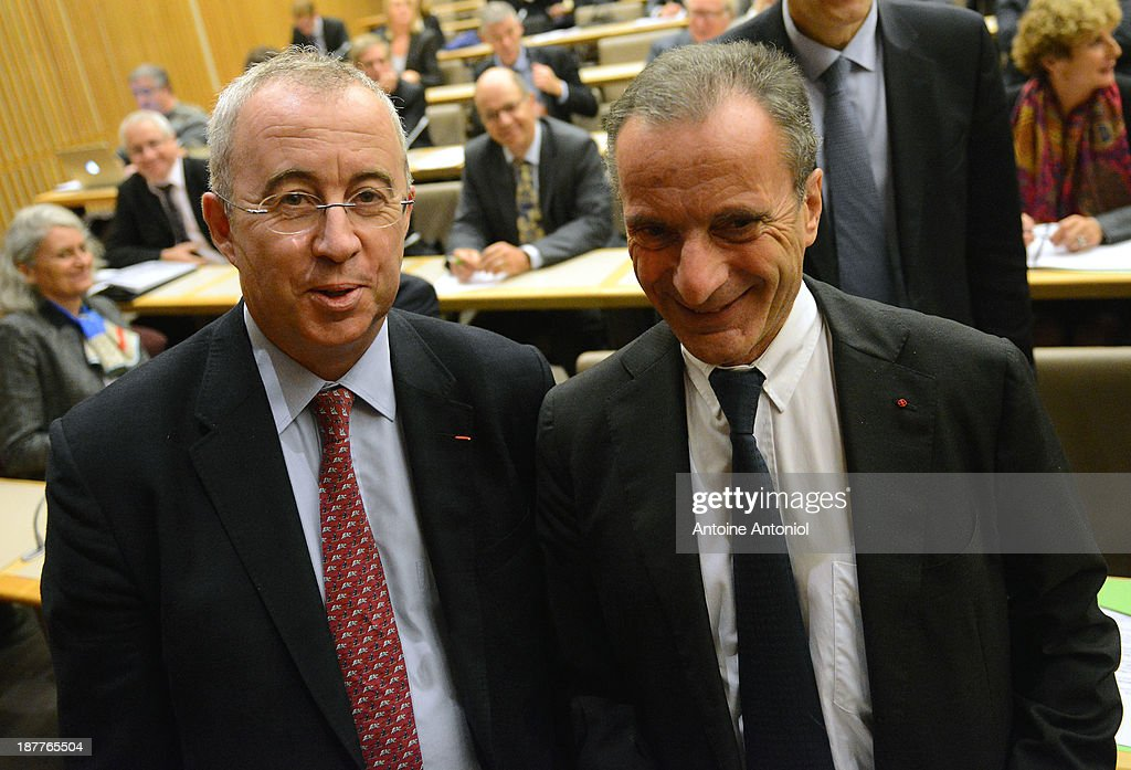 Electricite de France (EDF) CEO <a gi-track='captionPersonalityLinkClicked' href=/galleries/search?phrase=Henri+Proglio&family=editorial&specificpeople=569837 ng-click='$event.stopPropagation()'>Henri Proglio</a> (R) and Areva CEO Luc Oursel arrive at a press conference about nuclear energy on the international market on November 12, 2013 in Paris, France.