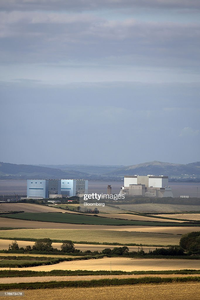 Electricite de France SA's (EDF) Hinkley Point A, left, and B, right, nuclear power stations stand beyond farmer's fields near Bridgwater, U.K., on Monday, Aug. 19, 2013. EDF's plans to build two Areva SA reactors at Hinkley Point in southwest England hinge on the price it will get from the U.K. government for the power it would produce. Photographer: Simon Dawson/Bloomberg via Getty Images