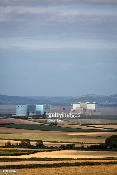 Electricite de France SA's Hinkley Point A left and B right nuclear power stations stand beyond farmer's fields near Bridgwater UK on Monday Aug 19...