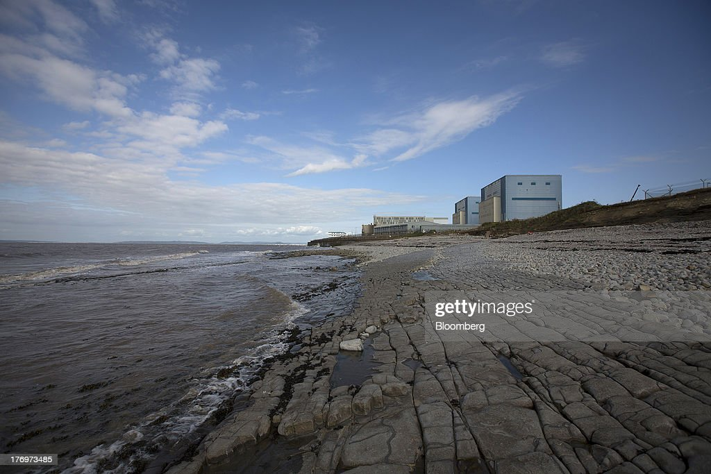 Electricite de France SA's (EDF) Hinkley Point A nuclear power station, right, stands on the bank of the Bristol Channel near Bridgwater, U.K., on Monday, Aug. 19, 2013. EDF's plans to build two Areva SA reactors at Hinkley Point in southwest England hinge on the price it will get from the U.K. government for the power it would produce. Photographer: Simon Dawson/Bloomberg via Getty Images