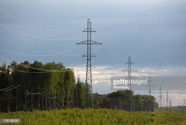 Electricity cables hang from pylons near a forested region in Salym KhantyMansi autonomous region Russia on Tuesday July 2 2013 Gazprom Neft and...
