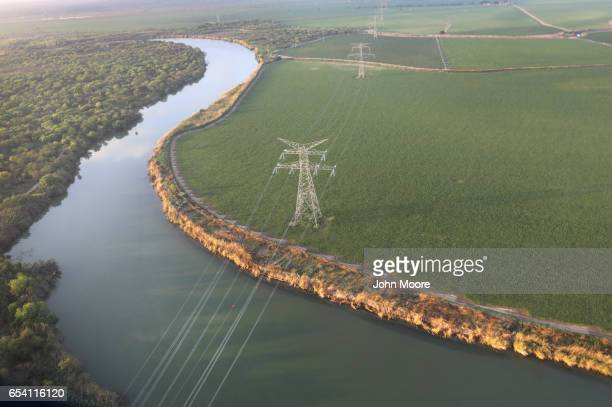 Electricity cables string over the Rio Grande from the United States into Mexico at the USMexico border on March 16 2017 near McAllen Texas US...
