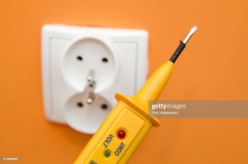 Electricity current meter, turn-screw near to the socket. : Stock Photo