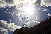Electricity Pylon against the sun