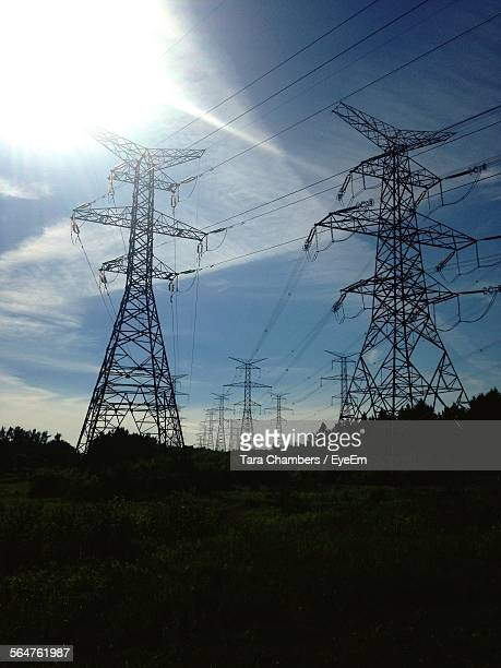Electricity Pylons Against Wispy Cloud