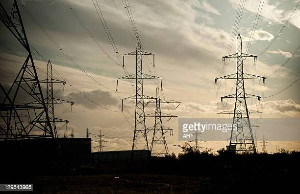 Electricity pylons are pictured near Barking Power Station in east London on October 18 2011 Britain's annual inflation surged to 52 percent in...