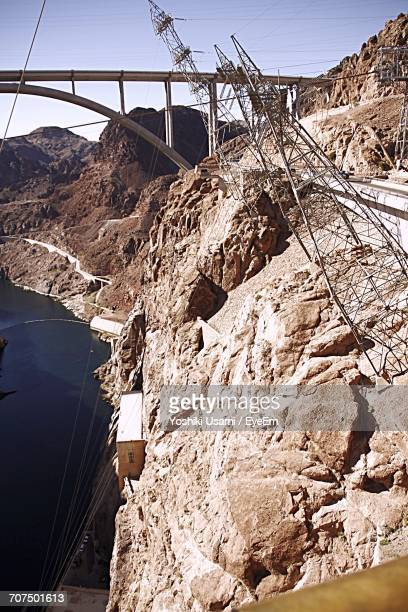 Electricity Pylons On Rocky Mountains At Hover Dam
