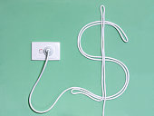 Electric wall outlet and power cord in the dollar sign to illustrate the concept of electricity cost, expense and bills.