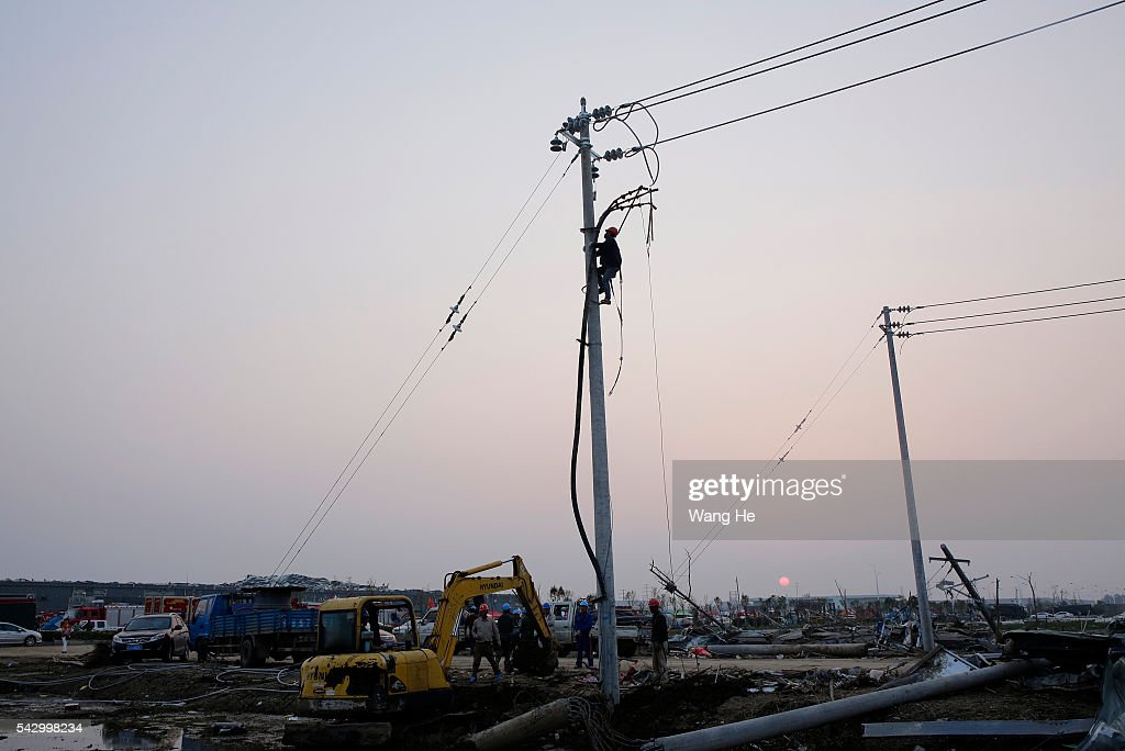 Electricity workers rush to repair electricity in Beichen Village of Chenliang Township in Funing, Yancheng, east China's Jiangsu Province on June 25, 2016. A total of 98 people were killed after severe storms in several towns in Jiangsu on Thursday, local rescue headquarters said on Friday. About 846 people sustained injuries, 200 of whom were seriously wounded, it said. More than 8,600 houses, two elementary schools and eight factory buildings were damaged in the counties of Funing and Sheyang, and parts of Yancheng City along the eastern coast of China. > on June 25, 2016 in Yancheng, China.