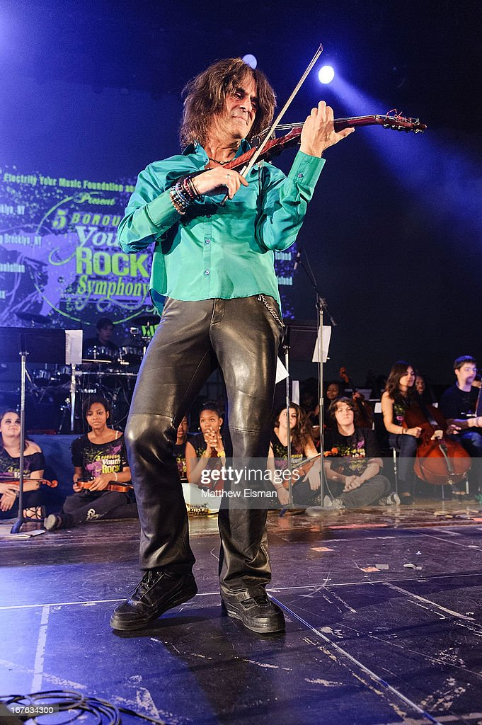 Electrify Your Music Foundation Founder/ electric violinist Mark Wood performs live with The 5-Borough Youth Rock Symphony at the Electrify Your Music Foundation launch event at Brooklyn Technical High School Theater on April 26, 2013 in the Brooklyn borough of New York City.