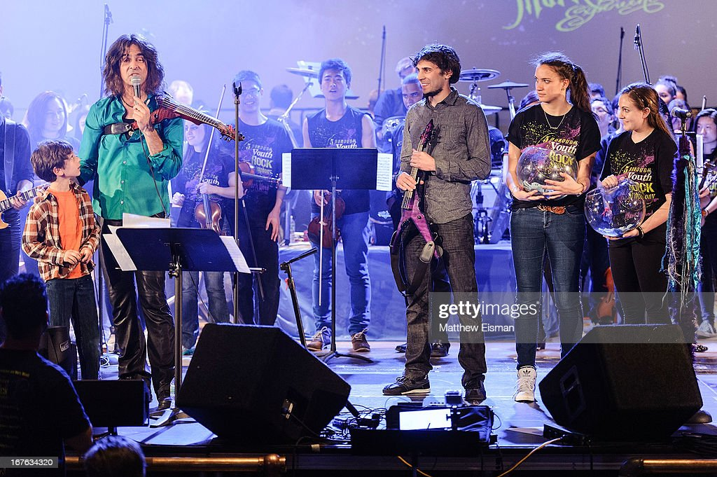 Electrify Your Music Foundation Founder/ electric violinist Mark Wood (L) performs live with The 5-Borough Youth Rock Symphony at the Electrify Your Music Foundation launch event at Brooklyn Technical High School Theater on April 26, 2013 in the Brooklyn borough of New York City.