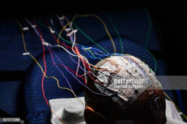 Electrodes are seen on the head of Swiss scientistadventurer and pilot Bertrand Piccard prior to a nonstop 72 hours simulation test flight inside a...
