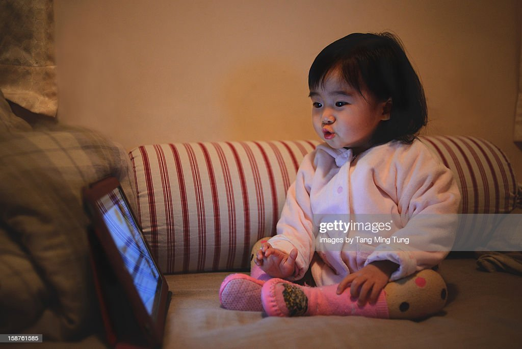 Electronic bed time story on tablet for baby : Stock Photo