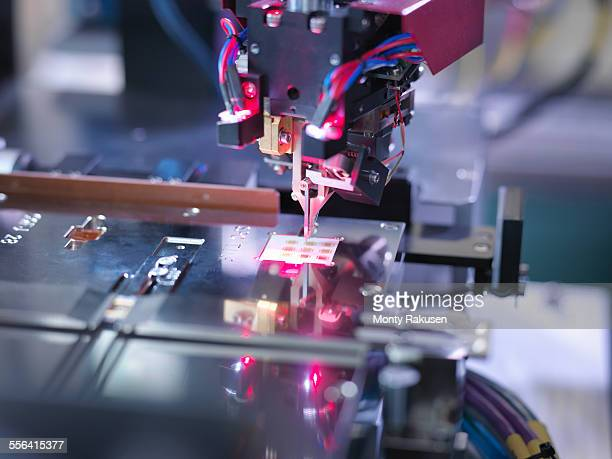 Electronic component in testing machine, close up