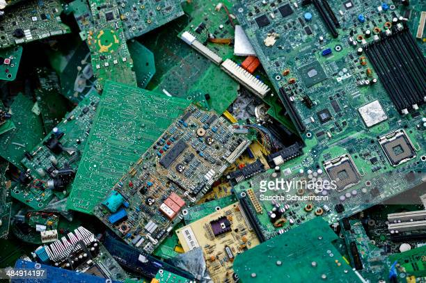 Electronic components including circuit boards sit in a pile before being melted down at the Aurubis recycling smelter on April 14 2014 in Luenen...