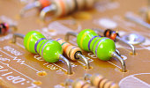 Closeup of resistors and diodes on a printed circuit board (PCB)