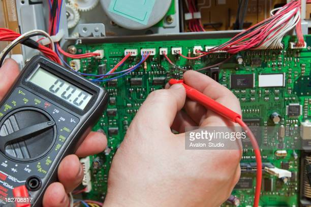 Electronic engineer measures the electronic circuits.