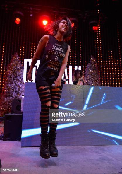 Electronic music artist Yasmine Yousaf of Krewella performs at AMP Radio's Toys For Teens drive at 5 Towers Outdoor Concert Arena on December 17 2013...