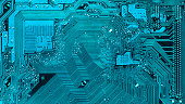 integrated circuit of the mainboard in turquoise. Visible electric paths