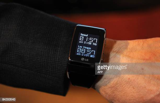 LG Electronics Chief Technology Officer Dr Woo Paik displays the world's first marketready Touch Watch Phone with 3G video telephony service and GSM...