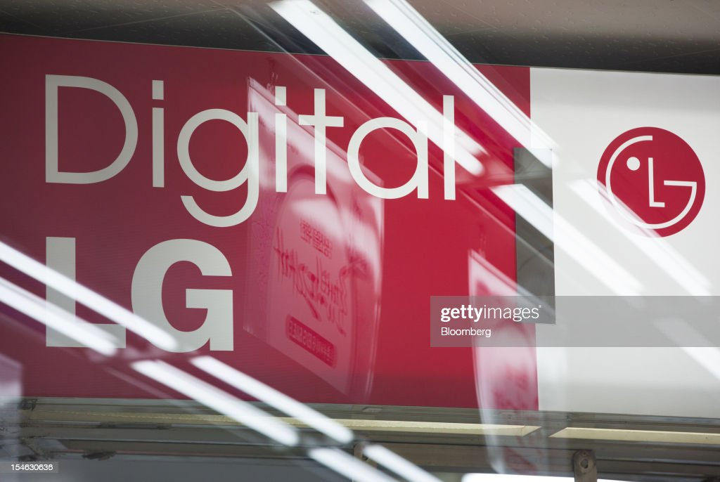 LG Electronics Inc. signage is displayed at an electronics store in Seoul, South Korea, on Tuesday, Oct. 23, 2012. LG is scheduled to release third-quarter earnings today. Photographer: SeongJoon Cho/Bloomberg via Getty Images