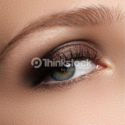 elegance closeup of female eye with classic dark brown smoky ma