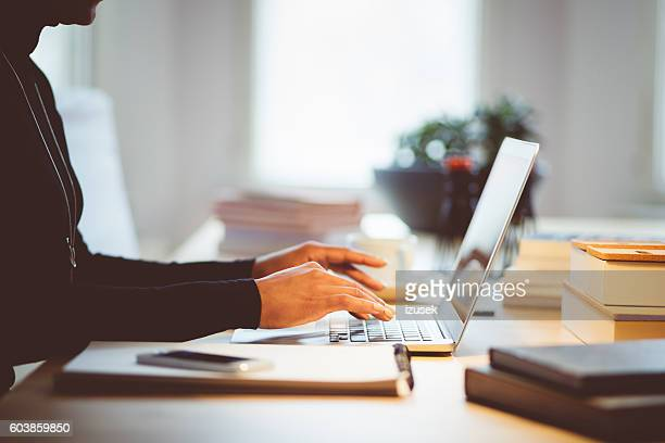 Elegance woman using laptop in an office or at home